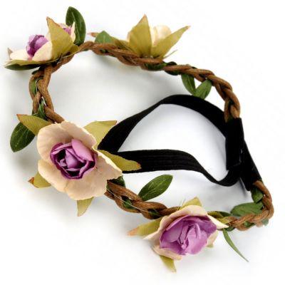 Haarschmuck mit lilafarbenen Stoffblumen