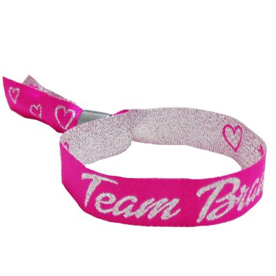 Pinkfarbenes JGA-Armband aus Stoff mit Team Braut-Schriftzug