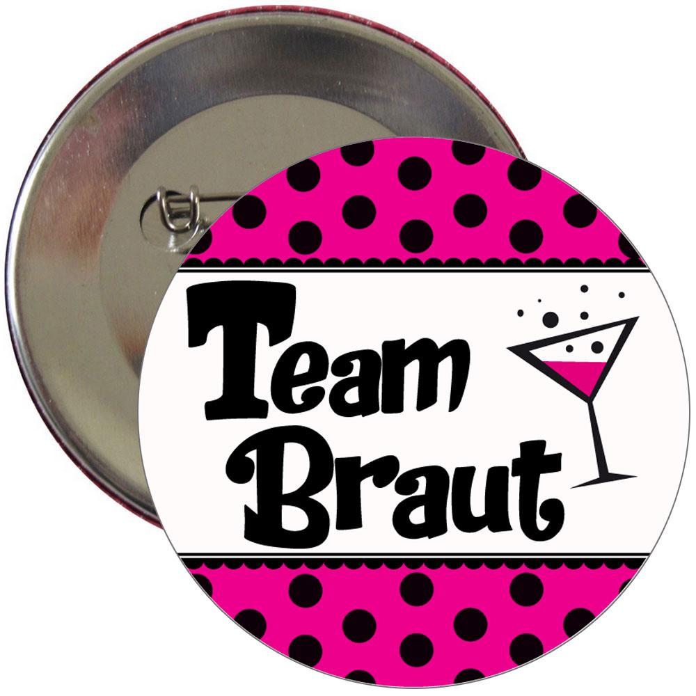 Pinkfarbener JGA-Button mit Team Braut-Logo und Punkten
