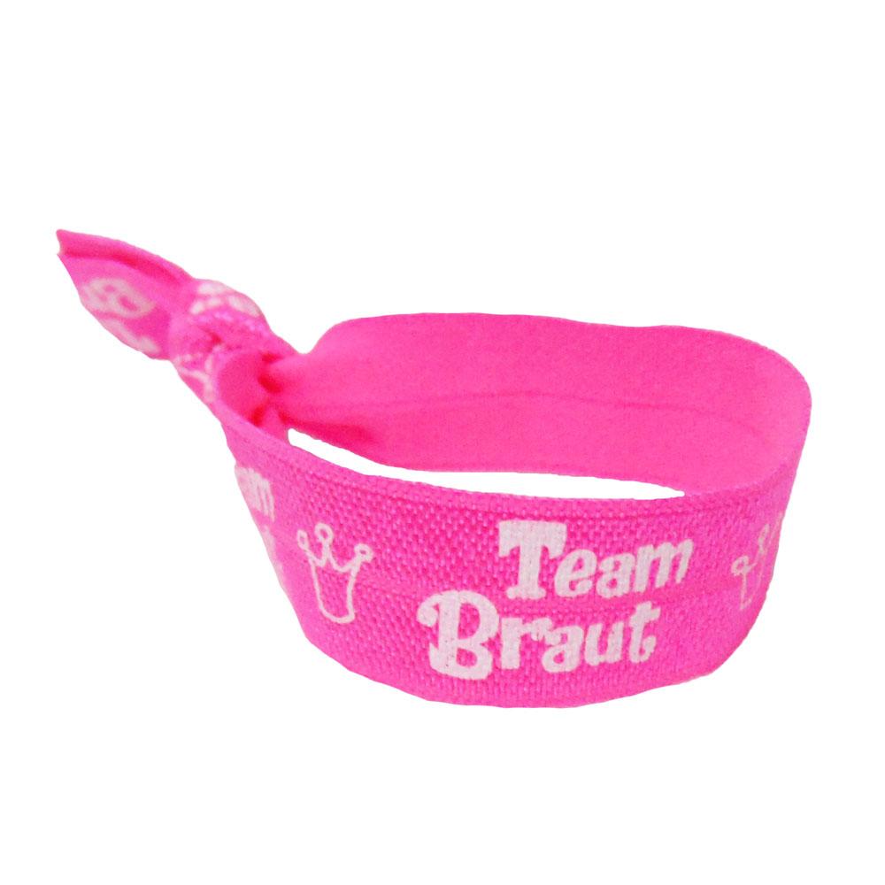 Pinkfarbenes Haargummi mit Team Braut-Aufdruck für den JGA