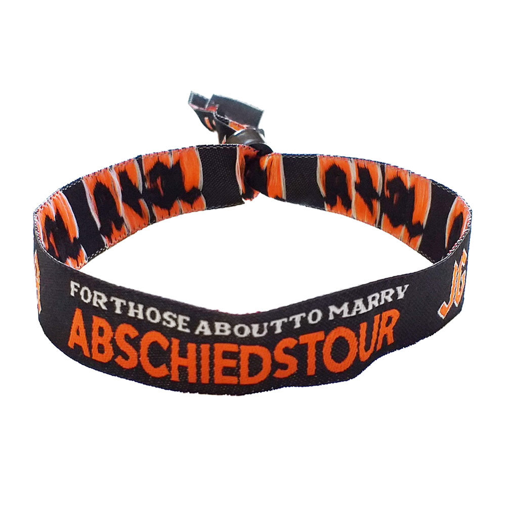 Stoff-Armband mit Rock vorm Ring-Motiv für den Junggesellenabschied