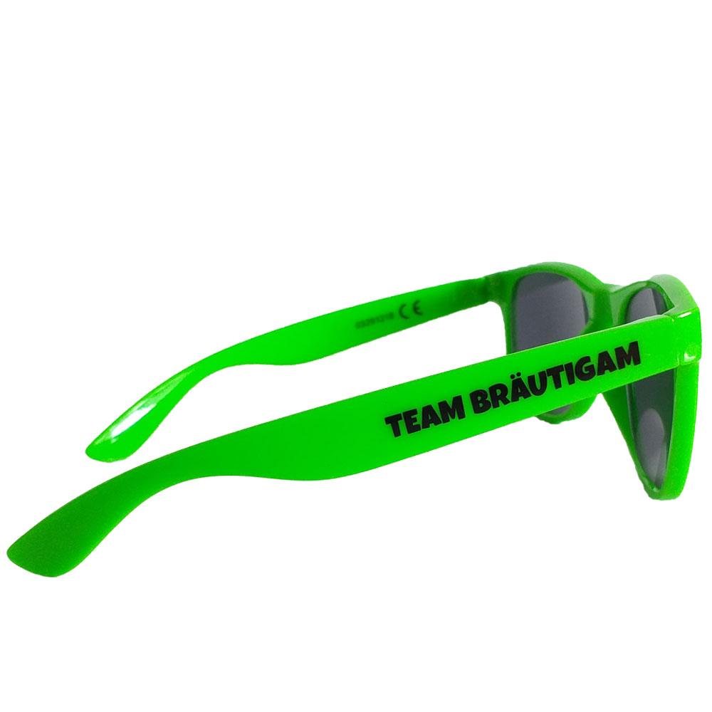 Grüne Fun-Sonnenbrille mit Rock vorm Ring-Aufschrift