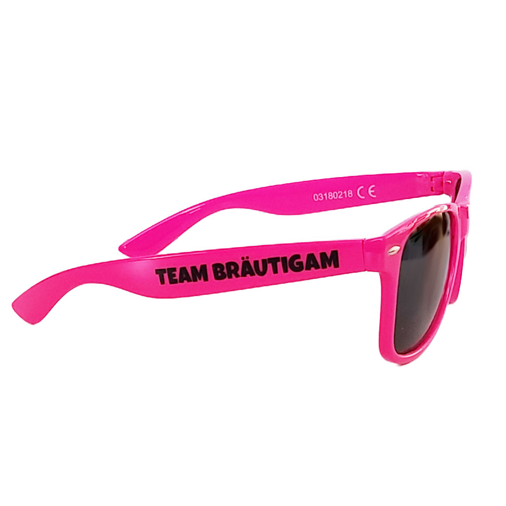 Pinkfarbene JGA Sonnenbrille mit Team Braeutigam-Aufdruck
