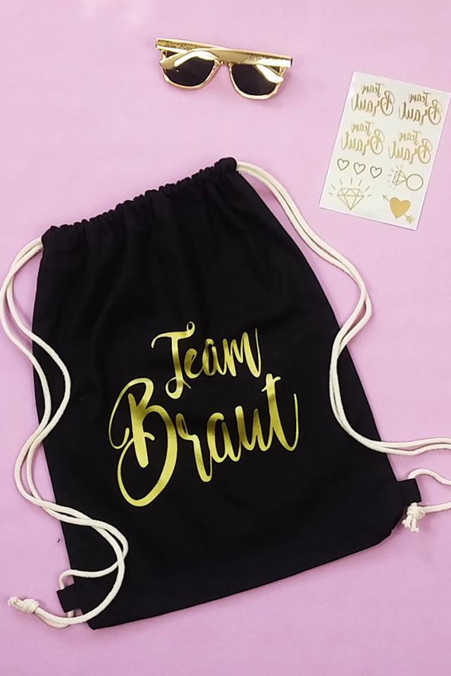 Team Braut JGA Accessoire Set in Schwarz-Gold - Turnbeutel mit Sonnenbrille und Tattoos